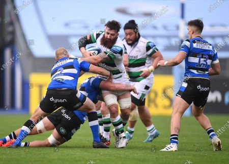 Stock Photo of Gary Graham of Newcastle Falcons is held up by Miles Reid and Jack Walker of Bath; Recreation Ground, Bath, Somerset, England; English Premiership Rugby, Bath versus Newcastle Falcons.