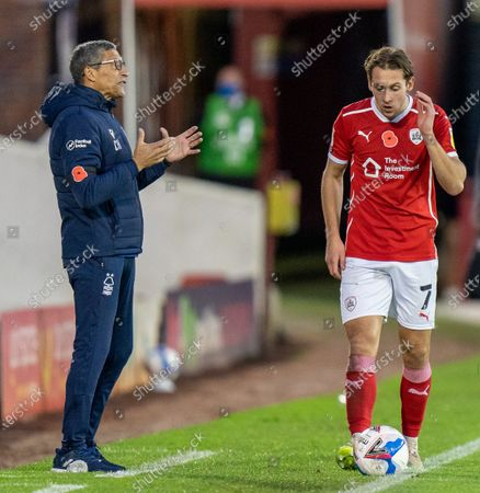 Chris Hughton of Nottingham Forrest shouting from side lines with Callum Brittain of Barnsley covering ear; 21st November 2020, Oakwell Stadium, Barnsley, Yorkshire, England; English Football League Championship Football, Barnsley FC versus Nottingham Forest.