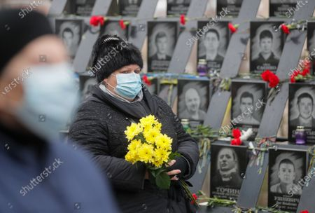 Ukrainians lay flowers at the memorial for Maidan activists or 'Heroes of the Heavenly Hundred', who were killed on the Maidan during anti-government protests in 2014, not far from Independence Square, amid the coronavirus COVID-19 pandemic, in Kiev, Ukraine, 21 November 2020. Ukrainians marked the anniversary of the Euromaidan revolution, commemorating 21 November 2013, on which activists started an anti-government picket after then-Prime Minister Mykola Azarov announced the suspension of a landmark treaty with the European Union. The protests eventually led to the ouster of President Viktor Yanukovych, creating political rifts through the country that erupted into a violent conflict between separatists and government forces in the eastern part of the country in the spring.