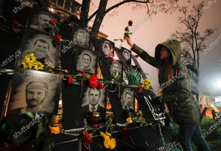 Ukrainians lay flowers at the memorial for Maidan activists or 'Heroes of the Heavenly Hundred', who were killed on the Maidan during anti-government protests in 2014, not far from Independence Square in Kiev, Ukraine, 21 November 2020. Ukrainians marked the anniversary of the Euromaidan revolution, commemorating 21 November 2013, on which activists started an anti-government picket after then-Prime Minister Mykola Azarov announced the suspension of a landmark treaty with the European Union. The protests eventually led to the ouster of President Viktor Yanukovych, creating political rifts through the country that erupted into a violent conflict between separatists and government forces in the eastern part of the country in the spring.