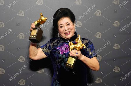 "Taiwanese actress Chen Shu-fang holds her awards for Best Leading Actress and Best Supporting Actress at the 57th Golden Horse Awards in Taipei, Taiwan, . Chen won for the film ""Dear Tenant"