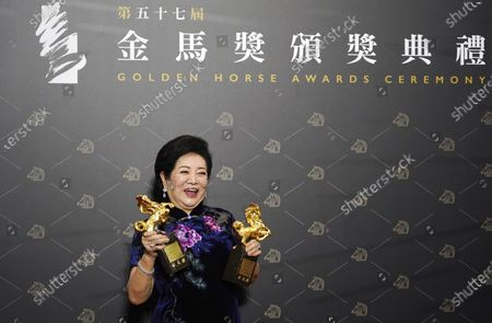 "Taiwanese actress Chen Shu-fang holds her awards for Best Leading Actress and Best Supporting Actress at the 57th Golden Horse Awards in Taipei, Taiwan, . Chen won for the film ""Dear Tenant"" at this year's Golden Horse Awards - one of the Chinese-language film industry's biggest annual events"