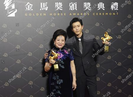 Taiwanese actress Chen Shu-fang and Taiwanese actor Mo Tzu-yi hold their awards for Best Leading Actress and Best Leading Actor at the 57th Golden Horse Awards in Taipei, Taiwan, . Golden Horse Awards is considered Asia's equivalent of the Academy Awards for Chinese-language films