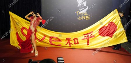 """Chinese-American actress Bai Ling poses with her slogan """"Love, Peace"""" at the 57th Golden Horse Awards in Taipei, Taiwan, . Bai is nominated for Best Leading Actress for the film """"The Abortionist"""" at this year's Golden Horse Awards -one of the Chinese-language film industry's biggest annual events"""
