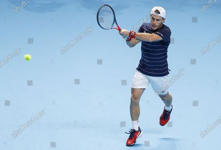 Diego Schwartzman of Argentina hits a return during the singles group match against Daniil Medvedev of Russia at the ATP World Tour Finals 2020 in London, Britain, on Nov. 20, 2020.