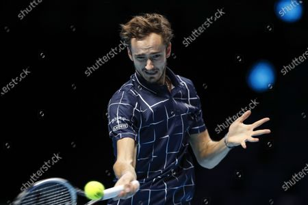 Daniil Medvedev of Russia hits a return during the singles group match against Diego Schwartzman of Argentina at the ATP World Tour Finals 2020 in London, Britain, on Nov. 20, 2020.