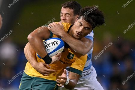 Jordan Petaia (L) of the Wallabies is tackled by Emiliano Boffelli of the Pumas during the Tri Nations rugby union match between the Argentina Pumas and Australian Wallabies at McDonald Jones Stadium in Newcastle, Australia, 21 November 2020.