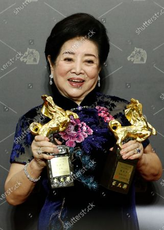 Taiwanese actress Chen Shu-fang poses with her awards for Best Leading Actress in the movie 'Little Big Women' and Best Supportive Actress in the movie 'Dear Tenant' at the 57th Golden Horse Awards ceremony in Taipei, Taiwan, 21 November 2020. The film awards established in 1962 are presented to filmmakers working in Chinese-language cinema.