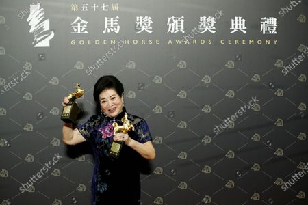 Stock Picture of Taiwanese actress Chen Shu-fang poses with her awards for Best Leading Actress in the movie 'Little Big Women' and Best Supportive Actress in the movie 'Dear Tenant' at the 57th Golden Horse Awards ceremony in Taipei, Taiwan, 21 November 2020. The film awards established in 1962 are presented to filmmakers working in Chinese-language cinema.