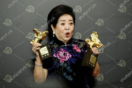 Stock Photo of Taiwanese actress Chen Shu-fang poses with her awards for Best Leading Actress in the movie 'Little Big Women' and Best Supportive Actress in the movie 'Dear Tenant' at the 57th Golden Horse Awards ceremony in Taipei, Taiwan, 21 November 2020. The film awards established in 1962 are presented to filmmakers working in Chinese-language cinema.