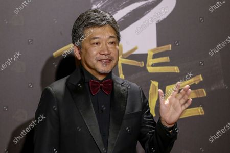 Stock Photo of Hirokazu Koreeda poses for photographs at the 57th Golden Horse Awards ceremony in Taipei, Taiwan, 21 November 2020. The film awards established in 1962 are presented to filmmakers working in Chinese-language cinema.