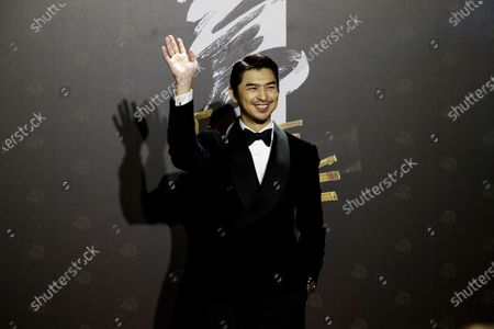 Chen Bolin poses for photographs at the 57th Golden Horse Awards ceremony in Taipei, Taiwan, 21 November 2020. The film awards established in 1962 are presented to filmmakers working in Chinese-language cinema.