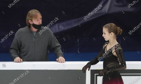 Stock Image of Alexandra Trusova of Russia and her coach Evgeni Plushenko talk during the Ladies Free Skating program at the 2020 Rostelecom Cup of Russia ISU Grand Prix of Figure Skating in Moscow, Russia, 21 November 2020.
