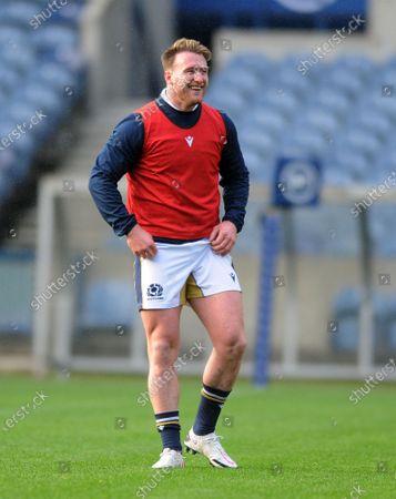Stuart Hogg - Scotland captain is in good spirits despite the rain shower.