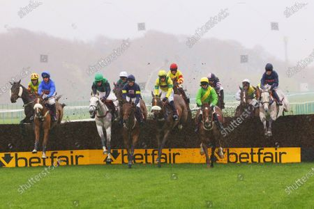 Over the first fence in the Betfair Supports Safer Gambling Week Handicap Chase at Haydock. L-R Secret Reprieve, Commodore, Bob Mahler, Newtide, Claud And Goldie and Snow Leopardess [Brian Hughes] right the winner.