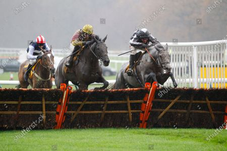 War Lord and Robbie Power [grey horse] win the Betfair Racing Only Bettor Handicap Hurdle at Haydock from Umbrigado.