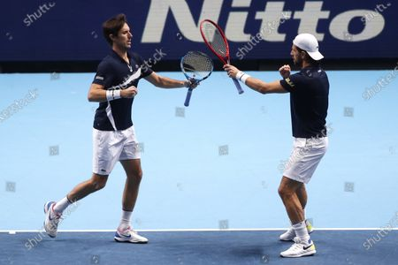 Jurgen Melzer of Austria, right, and Edouard Roger-Vasselin of France react during their double semifinal match against Rajeev Ram of the United States and Joe Salisbury of Britain at the ATP World Finals tennis tournament at the O2 arena in London