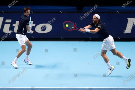 Jurgen Melzer of Austria, right, and Edouard Roger-Vasselin of France play during their double semifinal match against Rajeev Ram of the United States and Joe Salisbury of Britain at the ATP World Finals tennis tournament at the O2 arena in London