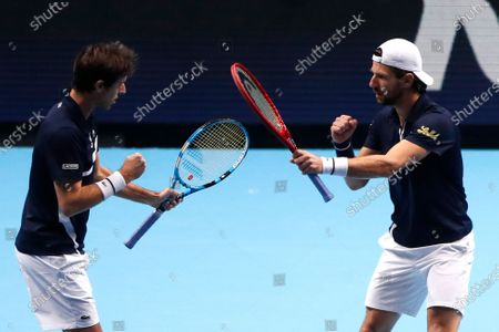 Stock Photo of Jurgen Melzer of Austria, right, and Edouard Roger-Vasselin of France celebrate during their double semifinal match against Rajeev Ram of the United States and Joe Salisbury of Britain at the ATP World Finals tennis tournament at the O2 arena in London
