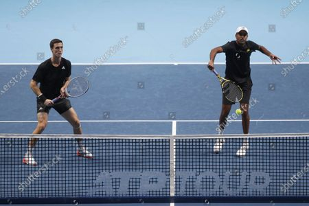 Rajeev Ram of the United States, right, and Joe Salisbury of Britain play during their double semifinal match against Jurgen Melzer of Austria, right, and Edouard Roger-Vasselin of France at the ATP World Finals tennis tournament at the O2 arena in London