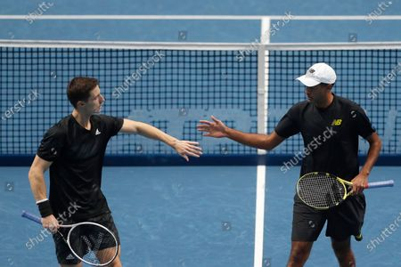 Stock Image of Rajeev Ram of the United States, right, and Joe Salisbury of Britain celebrate during their double semifinal match against Jurgen Melzer of Austria, right, and Edouard Roger-Vasselin of France at the ATP World Finals tennis tournament at the O2 arena in London