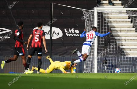 Alfa Semedo of Reading is pulled down for a penalty by Goalkeeper Asmir Begovic of Bournemouth.