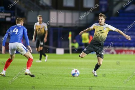 Crewe Alexandra midfielder Ryan Wintle (4) controls the ball ahead of Portsmouth midfielder Tom Naylor (4) during the EFL Sky Bet League 1 match between Portsmouth and Crewe Alexandra at Fratton Park, Portsmouth