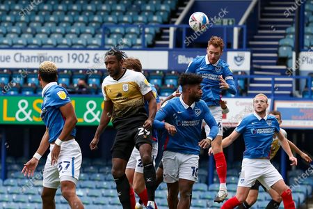 Portsmouth midfielder Tom Naylor (4) heads the ball clear during the EFL Sky Bet League 1 match between Portsmouth and Crewe Alexandra at Fratton Park, Portsmouth