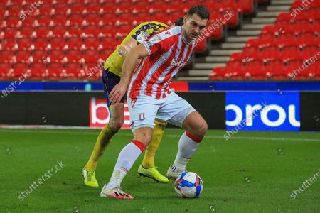 Sam Vokes (9) of Stoke City  on the ball during the EFL Sky Bet Championship match between Stoke City and Huddersfield Town at the Bet365 Stadium, Stoke-on-Trent