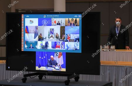 European Council President Charles Michel, U.S. President Donald Trump, European Commission President Ursula von der Leyen, Japan's Prime Minister Yoshihide Suga, South Korean President Moon Jae-in and Saudi Arabia's King Salman bin Abdulaziz Al Saud are seen on a screen before the start of the virtual G20 meeting hosted by Saudi Arabia, amid the coronavirus disease (COVID-19) outbreak, in Brussels, Belgium November 21, 2020.