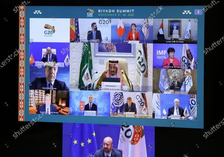 European Council President Charles Michel, Saudi Arabia's King Salman bin Abdulaziz Al Saud and other leaders are seen on a screen before the start of the virtual G20 meeting hosted by Saudi Arabia, amid the coronavirus disease (COVID-19) outbreak, in Brussels, Belgium November 21, 2020.