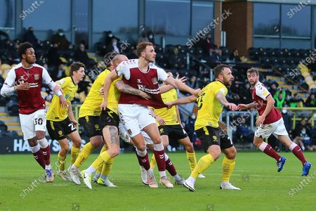 Northampton Town Forward Harry Smith (9) is closely marked during the EFL Sky Bet League 1 match between Burton Albion and Northampton Town at the Pirelli Stadium, Burton upon Trent