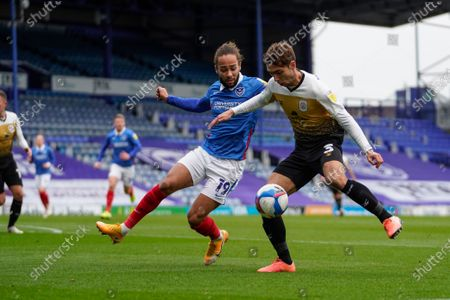 Harry Pickering of Crewe Alexandra on the attack, under pressure by Marcus Harness of Portsmouth during the EFL Sky Bet League 1 match between Portsmouth and Crewe Alexandra at Fratton Park, Portsmouth