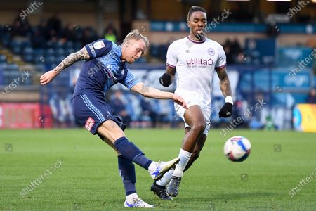 Wycombe Wanderers defender Sido Jambati (2) clears his lines under pressure from Brentford FC forward Ivan Toney (17) during the EFL Sky Bet Championship match between Wycombe Wanderers and Brentford at Adams Park, High Wycombe