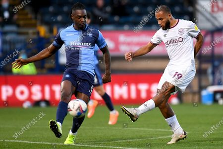 Stock Image of Brentford FC midfielder Bryan Mbeumo (19) takes a shot at goal under pressure from Wycombe Wanderers defender Anthony Stewart (5) during the EFL Sky Bet Championship match between Wycombe Wanderers and Brentford at Adams Park, High Wycombe