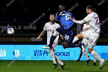 Stock Picture of Wycombe Wanderers striker Adebayo Akinfenwa (20) takes a shot at goal during the EFL Sky Bet Championship match between Wycombe Wanderers and Brentford at Adams Park, High Wycombe