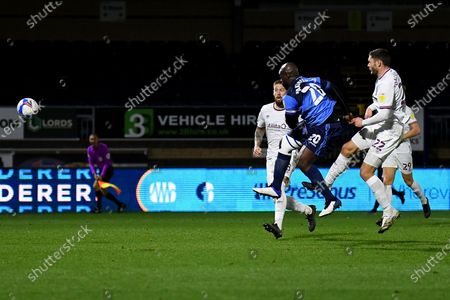 Stock Photo of Wycombe Wanderers striker Adebayo Akinfenwa (20) takes a shot at goal during the EFL Sky Bet Championship match between Wycombe Wanderers and Brentford at Adams Park, High Wycombe