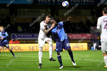 Brentford FC defender Pontus Jansson (18) battles for possession  with Wycombe Wanderers striker Adebayo Akinfenwa (20) during the EFL Sky Bet Championship match between Wycombe Wanderers and Brentford at Adams Park, High Wycombe