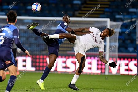 Brentford FC forward Ivan Toney (17) battles for possession  with Wycombe Wanderers defender Anthony Stewart (5) during the EFL Sky Bet Championship match between Wycombe Wanderers and Brentford at Adams Park, High Wycombe