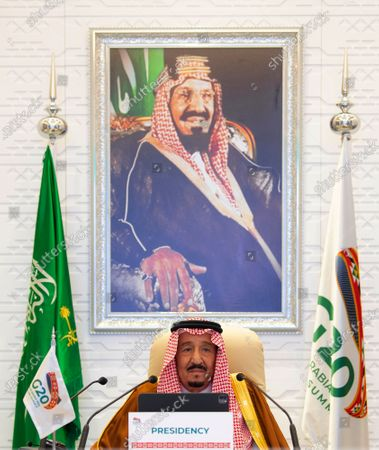 In this handout image provided by G20 Riyadh Summit, Saudi King Salman gives his opening remarks at a virtual G20 summit hosted by Saudi Arabia and held over video conference amid the Covid-19 pandemic, in Riyadh, Saudi Arabia