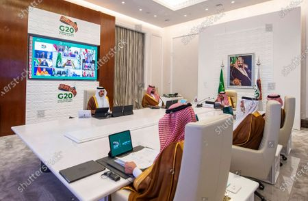 In this handout image provided by G20 Riyadh Summit, Saudi King Salman, top right, gives his opening remarks at a virtual G20 summit hosted by Saudi Arabia and held over video conference amid the COVID-19 pandemic, in Riyadh, Saudi Arabia