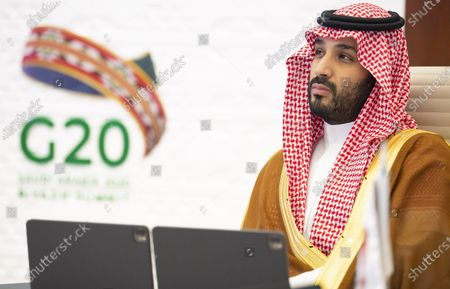 A handout photo made available by G20 Riyadh Summit shows Saudi Arabia's Crown Prince Mohammed bin Salman bin Abdulaziz Al Saud looking on as King Salman bin Abdulaziz Al Saud delivers opening remarks for the G20 Riyadh Summit, Riyadh, Saudi Arabia, 21 November 2020. The G20 Leaders' Summit will be held virtually on 21 and 22 November and is organized by Saudi Arabia's current G20 Presidency.