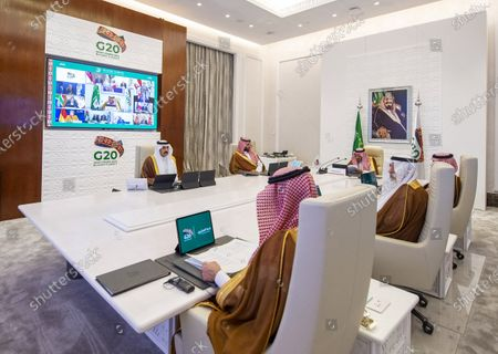 A handout photo made available by G20 Riyadh Summit shows Saudi Arabia's King Salman bin Abdulaziz Al Saud (3-L) delivering opening remarks for the G20 Riyadh Summit, Riyadh, Saudi Arabia, 21 November 2020. The G20 Leaders' Summit will be held virtually on 21 and 22 November and is organized by Saudi Arabia's current G20 Presidency.