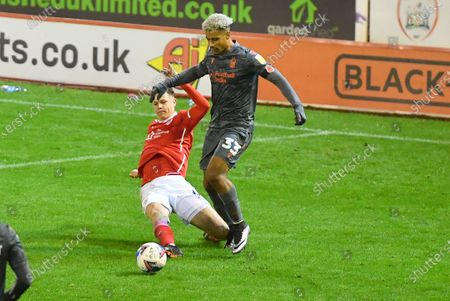 Stock Picture of Barnsley FC player Mads Juel Andersen (6) and Nottingham Forest Forward Lyle Taylor (33) during the EFL Sky Bet Championship match between Barnsley and Nottingham Forest at Oakwell, Barnsley