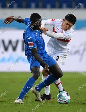 Ihlas Bebou (L) of TSG 1899 Hoffenheim is challenged by Wataru Endo of VfB Stuttgart    during the Germany Bundesliga soccer match between TSG Hoffenheim and VfB Stuttgart at PreZero-Arena in Sinsheim, Germany, 21 November 2020.