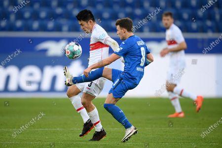 Wataru Endo (L) of VfB Stuttgart is challenged by Dennis Geiger of TSG 1899 Hoffenheim during the Germany Bundesliga soccer match between TSG Hoffenheim and VfB Stuttgart at PreZero-Arena in Sinsheim, Germany, 21 November 2020.