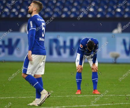 Schalke's Matija Nastasic and Schalke's Steven Skrzybski (R) react after losing the German Bundesliga soccer match between FC Schalke 04 and VfL Wolfsburg in Gelsenkirchen, Germany, 21 November 2020.