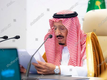 In this handout image provided by Saudi Royal Palace, Saudi King Salman gives his opening remarks at a virtual G20 summit hosted by Saudi Arabia and held over video conference amid the COVID-19 pandemic, in Riyadh, Saudi Arabia