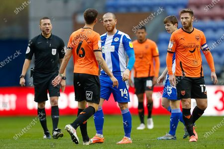 Wigan Athletic FC Forward and Captain Joe Garner (14) pushes Oxford United FC Midfielder Alex Rodriguez Gorrin (6) after a disagreement during the EFL Sky Bet League 1 match between Wigan Athletic and Oxford United at the DW Stadium, Wigan