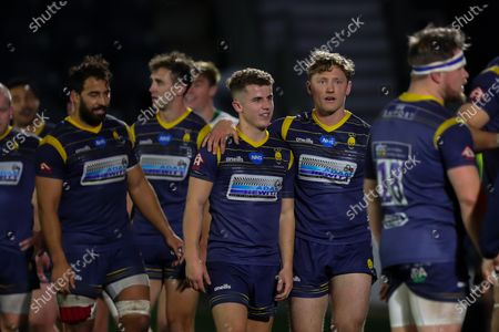 Billy Searle and Tom Howe of Worcester Warriors celebrate their narrow victory over London Irish